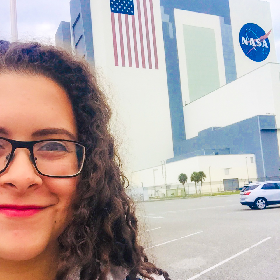 Ely in front of the NASA Control Center buidling.