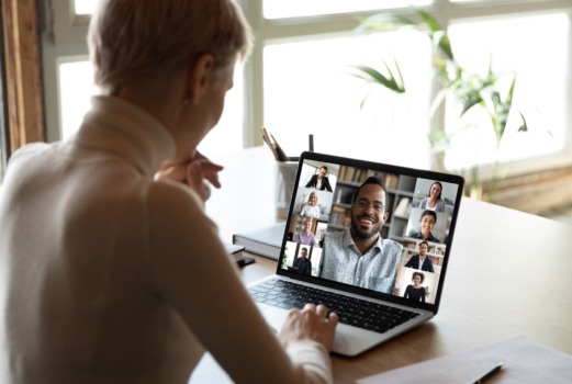 A woman conducts a video conference on her laptop.