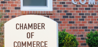 Brick building with Chamber of Commerce on sign in front