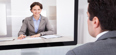 A man in a suit holds a video conference call.