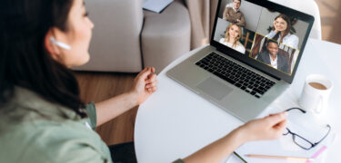 Online teaching. Young girl teacher conducts a lesson by video conference to her students