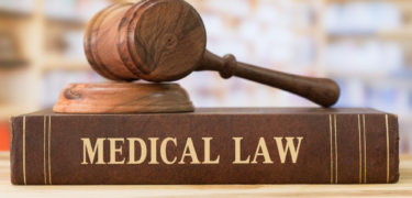 """A gavel on top of a book titled, """"Medical Law."""""""