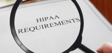 """A magnifying glass over a document titled, """"HIPAA Requirements."""""""