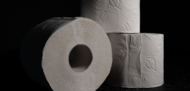 A close up of three toilet paper rolls.