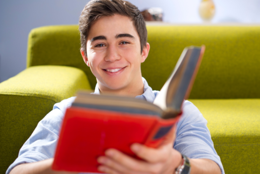 A student holding a book.
