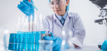 A healthcare professional working on vials.