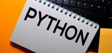 """The word """"Python"""" on a notepad."""