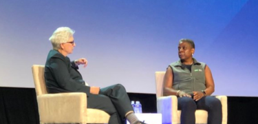 An interviewer and Ursula Burns sit together.