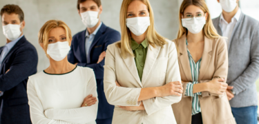 A group of businesspeople wearing masks.