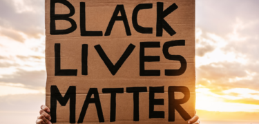 A Black Lives Matter sign is held up.