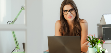 A woman at a desk with a laptop.